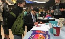 John Miller signing his book