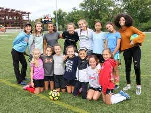 soccer players and intern